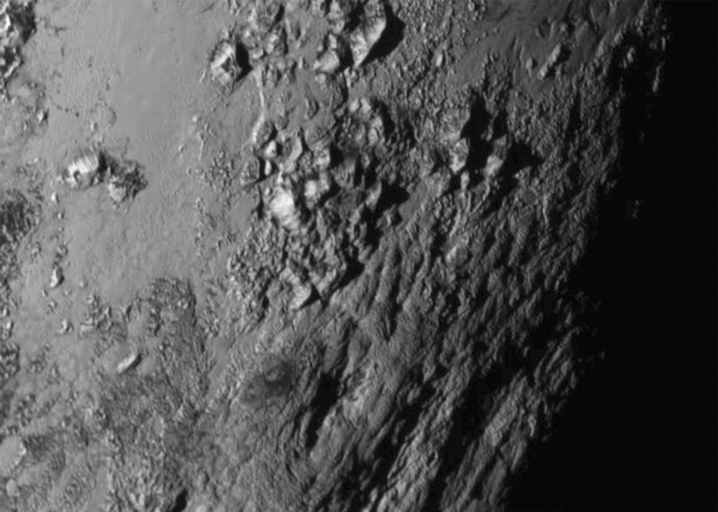 Pluto,Pluto's ice mountains and water,Pluto's ice mountains and water Pictures,Pluto's ice mountains and water pics,Pluto's ice mountains and water images,Pluto's ice mountains and water photos,Pluto's ice mountains and water stills,NASA releases Pluto im