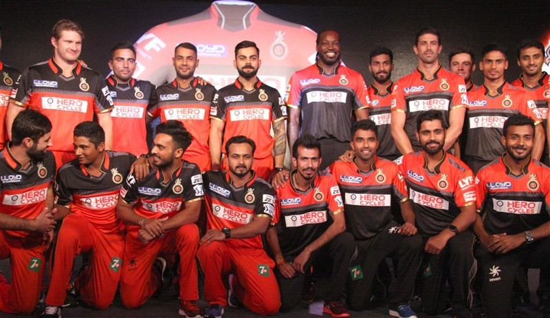 RCB unveils new jersey,RCB unveils new jersey with two designs,Royal Challengers Bangalore,Royal Challengers Bangalore new jersey,Virat Kohli,Chris Gayle,Virat Kohli and Chris Gayle