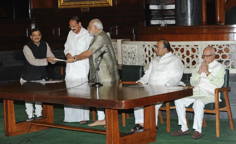 Rajya Sabha member Tarun Vijay on Tuesday presented a book on Narendra Modi in Chinese language, in the presence of M Venkaiah Naidu, Arun Jaitley and LK Advani in the Central Hall of Parliament.
