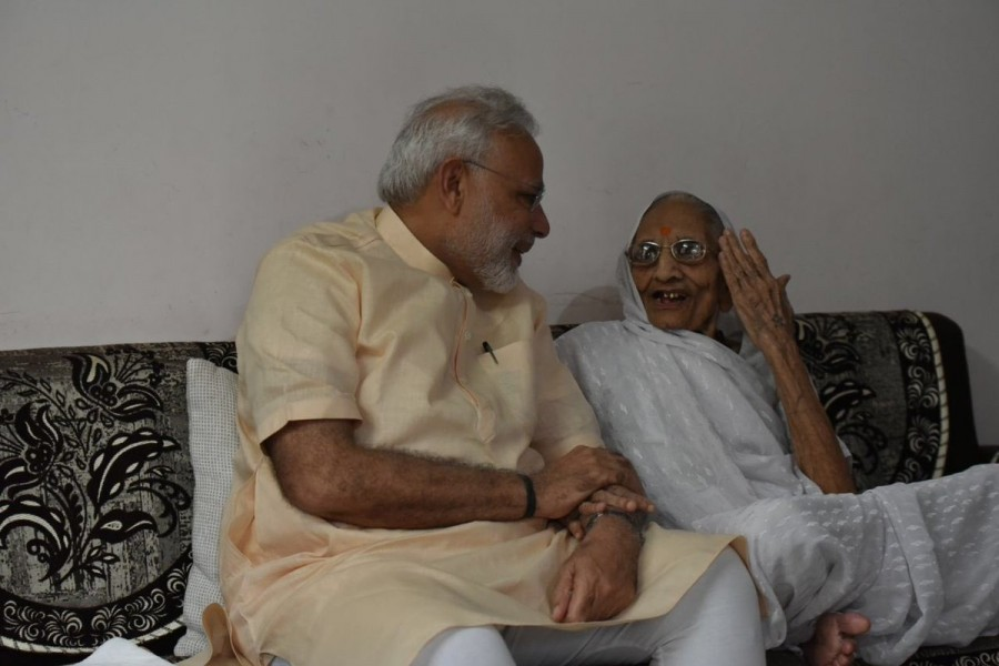 Narendra Modi,Modi celebrates birthday with his mother,Narendra Modi mother,Modi mother,Narendra Modi birthday,PM Modi,Narendra Modi birthday celebrations,Narendra Modi birthday pics,Narendra Modi birthday images,Narendra Modi birthday photos,Narendra Mod
