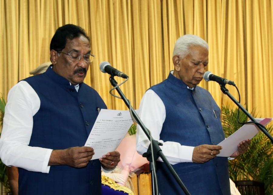 KJ George,KJ George swears in as Minister,KJ George is back,KJ George as Minister,Governor Vajubhai R Vala,Siddaramaiah,CM Siddaramaiah,KJ George swars