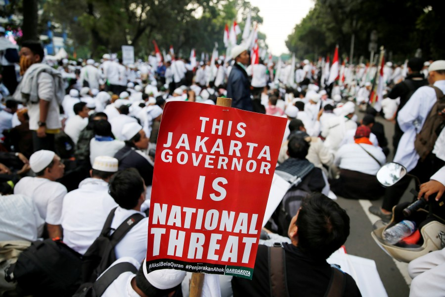 Hardline Muslims,massive rally in Indonesia,Muslim protesters,hardline Muslim protesters rally,hardline Muslim protesters,Koran,Islam Love Peace