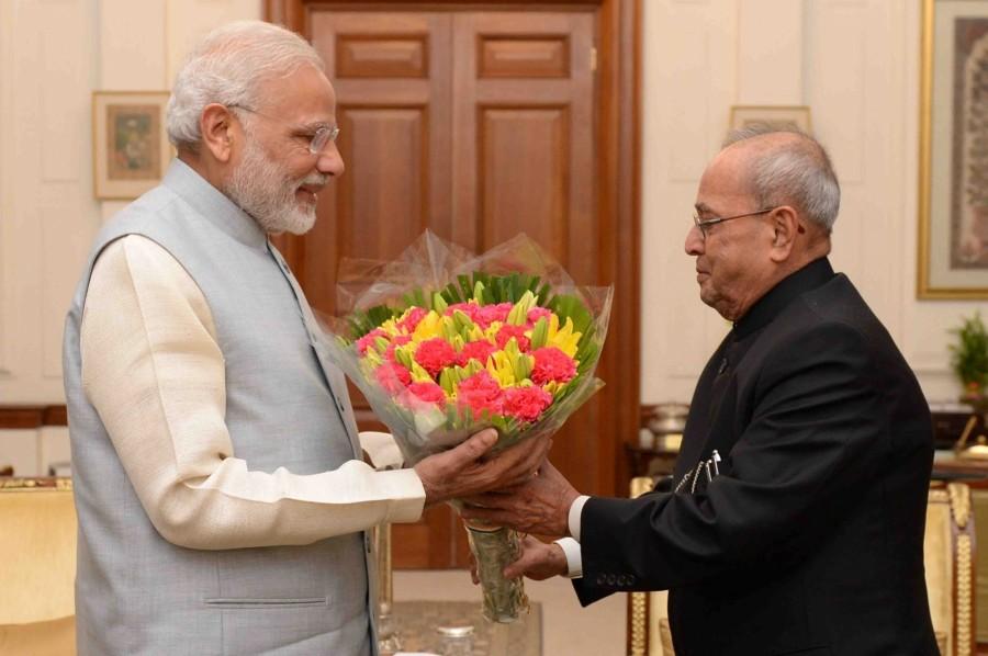 PM Narendra Modi,Prime Minister Narendra Modi,Narendra Modi,Modi,Pranab Mukherjee,President Pranab Mukherjee,Modi meets president Pranab Mukherjee,Modi meets Mukherjee,Rashtrapati Bhavan
