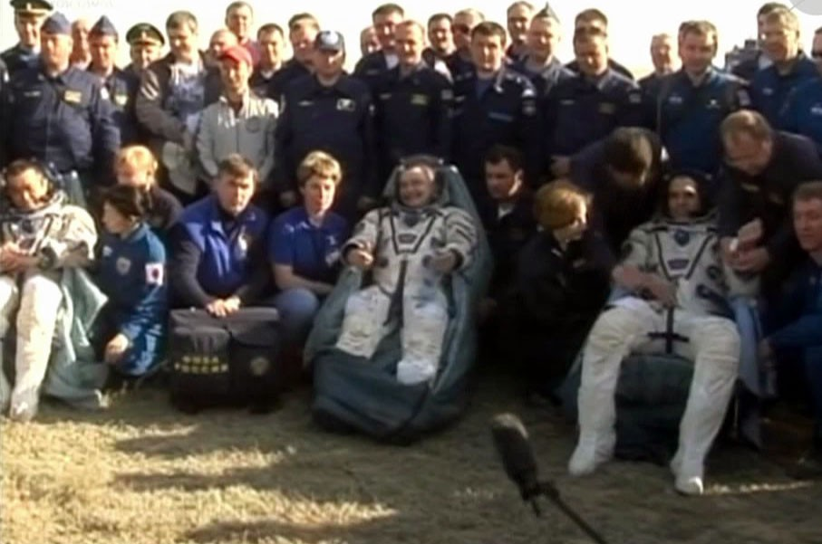 The Expedition 39 crew adjusts to the full force of Earth's gravity shortly after landing in Kazakhstan aboard their Soyuz spacecraft. (NASA TV)
