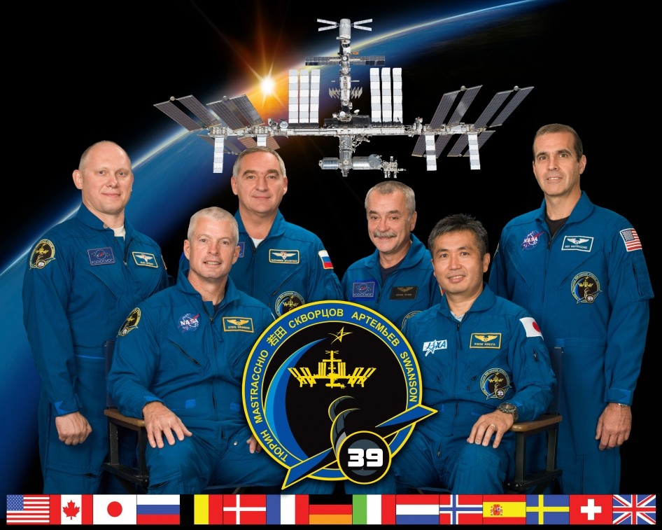 Expedition 39 crew members take a break from training at NASA's Johnson Space Center to pose for a crew portrait. Pictured on the front row are Japan Aerospace Exploration Agency (JAXA) astronaut Koichi Wakata (right), commander; and NASA astronaut Steve