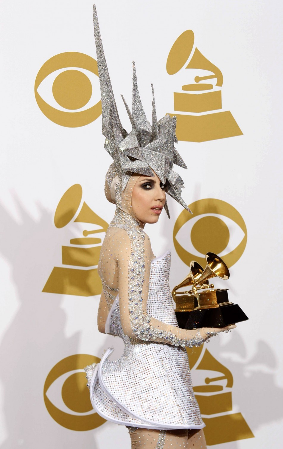 Lady Gaga holds her two Grammy awards at the 52nd annual Grammy Awards in Los Angeles