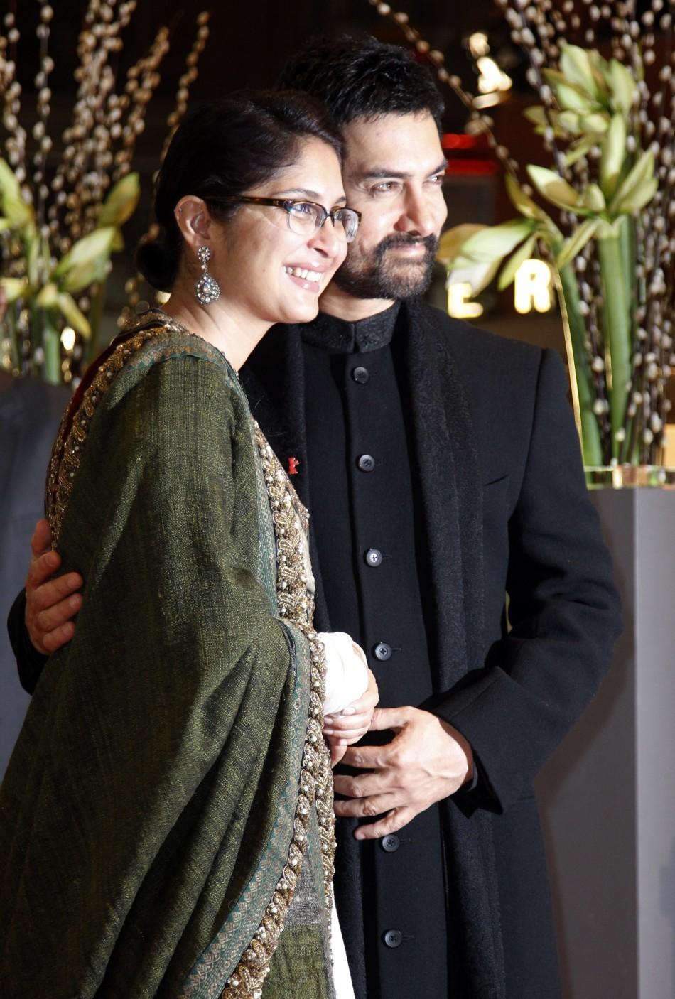 Bollywood actor Aamir Khan (R) and his wife Kiran Rao arrive at the red carpet for the opening U.S. movie 'True Grit' at the 61st Berlinale International Film Festival in Berlin February 10, 2011.