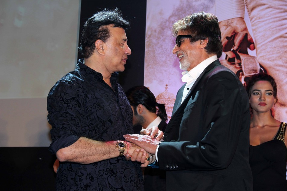 Music director Anu Malik and Amitabh bachchan share a friendly moment