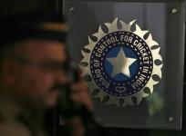 a-policeman-walks-past-a-logo-of-the-board-of-control-for-cricket-in-india-bcci-during-a-governing-council-meeting-of-the-indian-premier-league-ipl-at-bcci-headquarters-in-mumbai-april-26-2010