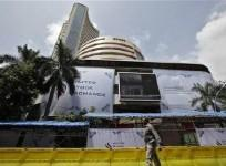 a-man-walks-past-the-bombay-stock-exchange-bse-building-in-mumbai