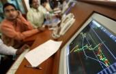 Indian stock brokers watch the key Sensex share index graph in a brokerage firm in Mumbai May 13, 2004.