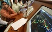 indian-stock-brokers-watch-the-key-sensex-share-index-graph-in-a-brokerage-firm-in-mumbai-may-13-2004