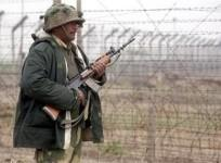 A Border Security Force (BSF) soldier patrols near the fenced border with Pakistan in Suchetgarh, southwest of Jammu, January 20, 2010.