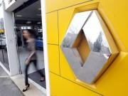 a-woman-leaves-a-renault-automobile-dealership-in-marseille