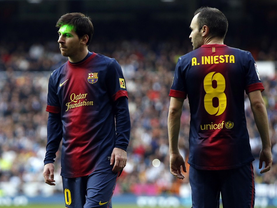 Barcelona's Lionel Messi and Andres Iniesta