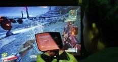 a-man-tries-a-game-at-the-nvidia-shield-pc-game-streaming-exhibit-at-e3-the-electronic-entertainment-expo-in-los-angeles-california-june-11-2013-credit-reuters-david-mcnew-files