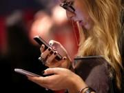 a-consumer-checks-out-smartphones-reuters