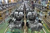 a-worker-assembles-an-engine-inside-the-royal-enfield-motorcycle-factory-in-chennai-april-6-2012