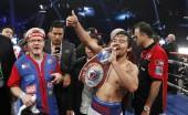 pacquiao-of-the-philippines-celebrates-his-victory-over-bradley-of-the-u-s-after-their-title-fight-at-the-mgm-grand-garden-arena-in-las-vegas