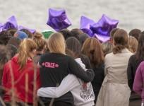 people-gather-at-the-beach-for-a-vigil-in-honor-of-slain-student-maren-sanchez-in-milford