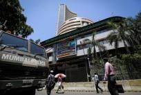 People walk past the Bombay Stock Exchange (BSE) building in Mumbai (Reuters)