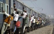 Commuters hang onto a crowded local passenger train in the eastern Indian city of Patna (Reuters file)
