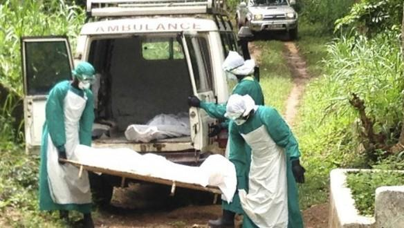 Health workers carry the body of an Ebola virus victim in Kenema