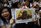Students from all-girls Catholic school, St Scholastica's College, chant slogans as they display poster of, according to students, a Boko Haram militant during a rally in Manila