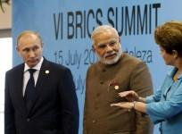 Brazil's President Rousseff talks to Russia's President Putin and India's Prime Minister Modi while they pose for a group picture during the VI BRICS Summit in Fortaleza