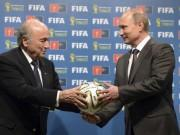 Russian President Vladimir Putin (R) and FIFA President Sepp Blatter at the official handover ceremony of the 2018 World Cup.