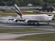 An Emirates Airbus A380 lands on the runway at Manchester Airport at Manchester Airport, northern England June 25, 2013