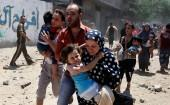 A Palestinian family runs for cover during an Israeli shelling