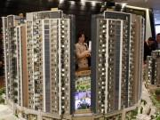 A potential buyer looks at a model of Riva, one of the latest developments by Sun Hung Kai Properties, in Hong Kong