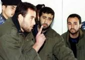 (L-R) Raed al-Attar, Mohammed Abu Shammala and Osama Abu Atah from Hamas, stand before a Palestinian Authority court in Gaza in this February 27, 1999 file photo.