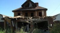 artillery-pounding-leaves-donetsk-residential-street-in-ruins