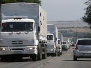 Russian aid convoy of nearly 300 trucks entered the Ukrainian border despite Kiev's objection as reports of artillery fired inside Ukraine.