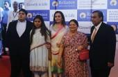 Mukesh Ambani with his son Akash, daughter Isha, wife Nita and mother Kokilaben