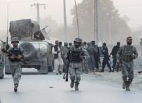 Afghan security forces arrive at the site of an attack in the city of Jalalabad August 30, 2014. At least six people were killed and dozens wounded when a suicide car bomber and Taliban gunmen attacked an office of the Afghan intelligence agency in the ea