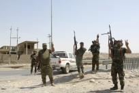 Iraqi security forces and Iraqi Shi'ite volunteers react after breaking a siege by the Islamic State extremist group on Amerli August 31, 2014.