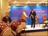 pm-narendra-modi-plays-taiko-drums-at-tcs-event-in-tokyo