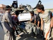 People carry a remnant of a war plane that crashed on the outskirts of Raqqa in northeast Syria September 16, 2014.