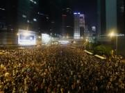 Tens of thousands of protesters block the main street to the financial Central district (at background) outside the government headquarters in Hong Kong September 28, 2014.