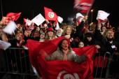 Nidaa Tounes (Call for Tunisia) supporters wave flags and shout slogans