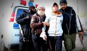 Isis fighters escort the young man accused of stealing a motorbike in Raqqa.