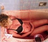 Californian model Chanel takes bath in pig blood