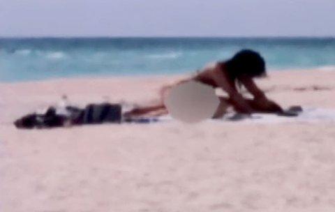 headlines woman filmed having beach front kids