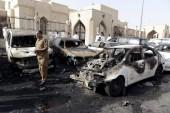 A policeman inspects the site of a car bomb near the Shi'ite al-Anoud mosque in Saudi Arabia's city Dammam