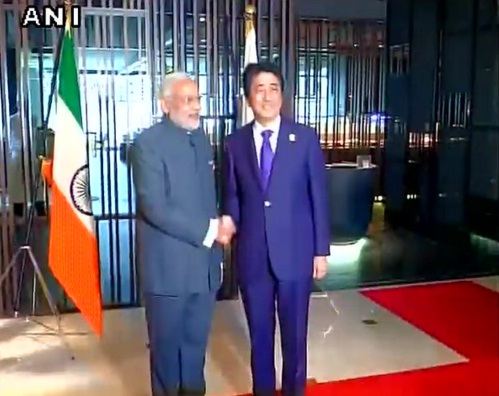 Indian flag upside down as Modi, Abe pose for cameras at ...