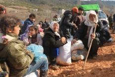 Syrians flee to Turkish borders