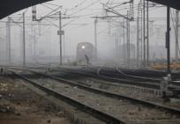 rail stocks wagons engineering texmaco kalindee titagarh rail nirman indian railways prabhu track renewal expansion infra push govt A labourer pushes a handcart past a train as he crosses railway tracks on a foggy and cold winter morning in New Delhi Janu